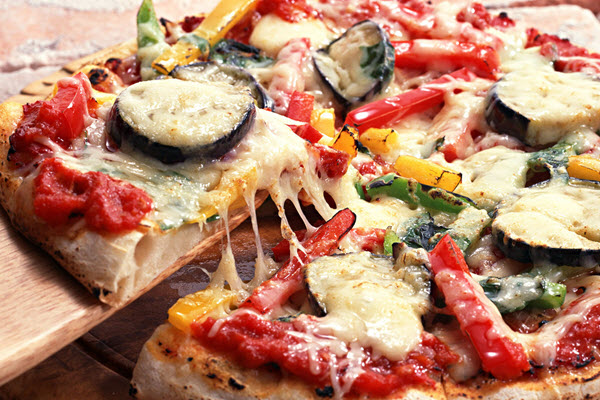 manger des pizzas à Manhattan